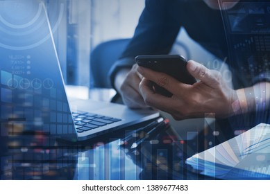 Business technology, business intelligence concept, digital diagram, graph interface. Businessman working at modern office. Man using mobile smart phone, laptop with financial data, dashboard computer