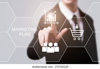 business, technology and internet concept - businessman pressing marketing plan button on virtual screens