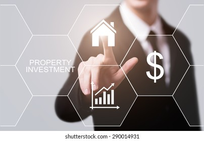 business, technology and internet concept - businessman pressing property investment button on virtual screens