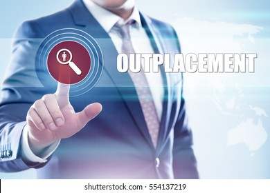 Business, technology, internet concept on hexagons and transparent honeycomb background. Businessman  pressing button on touch screen interface and select  outplacement
