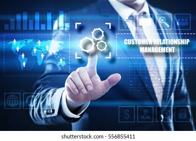 Business, technology, internet concept on hexagons and transparent honeycomb background. Businessman  pressing button on touch screen interface and select  crm
