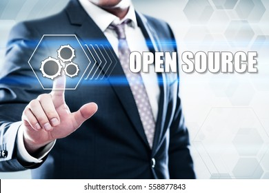 Business, technology, internet concept on hexagons and transparent honeycomb background. Businessman  pressing button on touch screen interface and select  open source