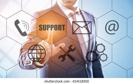 business, technology, internet and customer service concept. Businessman pressing support button on virtual screens with hexagons and transparent honeycomb