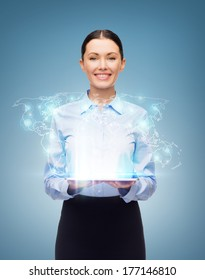 business, technology, internet and education concept - friendly young smiling businesswoman with world map hologram from tablet pc screen