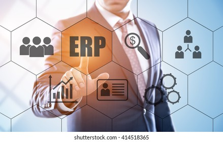 business, technology, internet and enterprise resource planning concept. Businessman pressing erp button on virtual screens with hexagons and transparent honeycomb