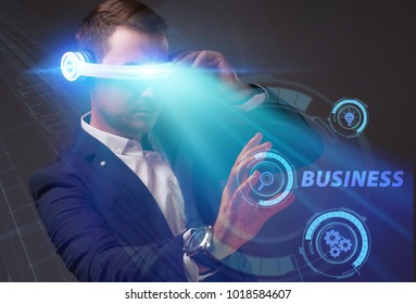 Business, Technology, Internet and network concept. Young businessman working on a virtual screen of the future and sees the inscription: Business