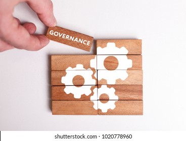 Business, Technology, Internet and network concept. Young businessman shows the word: Governance