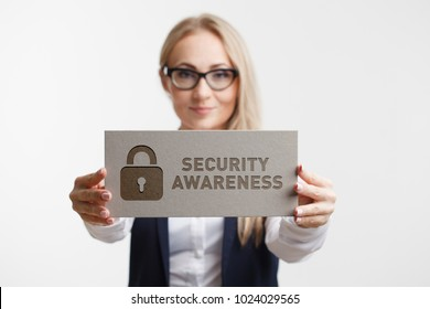 Business, Technology, Internet and network concept. Young girl holding a sign with an inscription Security Awareness
