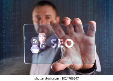 Business, Technology, Internet and network concept. Young businessman working on a virtual screen of the future and sees the inscription: SEO