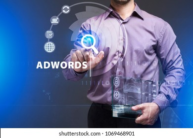 Business, Technology, Internet and network concept. Young businessman working on a virtual screen of the future and sees the inscription: AdWords