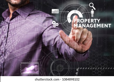 Business, Technology, Internet and network concept. Young businessman working on a virtual screen of the future and sees the inscription: Property management