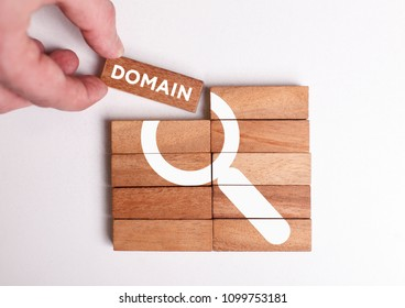 Business, Technology, Internet and network concept. Young businessman shows the word: Domain
