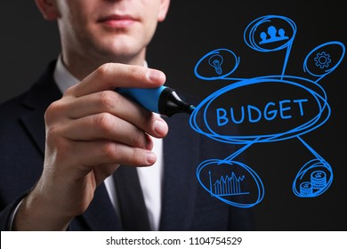 Business, Technology, Internet and network concept. Young business man writing word: Budget