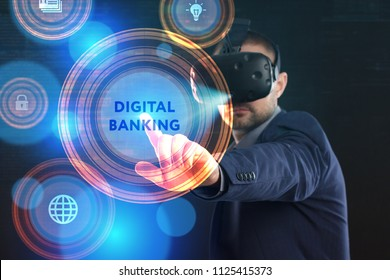 Business, Technology, Internet and network concept. Young businessman working in virtual reality glasses sees the inscription: Digital banking