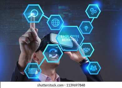 Business, Technology, Internet and network concept. Young businessman working on a virtual screen of the future and sees the inscription: Employee benefits