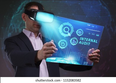 Business, Technology, Internet and network concept. Young businessman working in virtual reality glasses sees the inscription: Internal audit