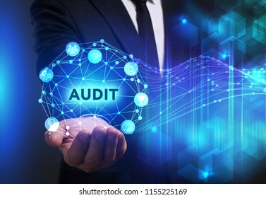 Business, Technology, Internet and network concept. Young businessman working on a virtual screen of the future and sees the inscription: Audit