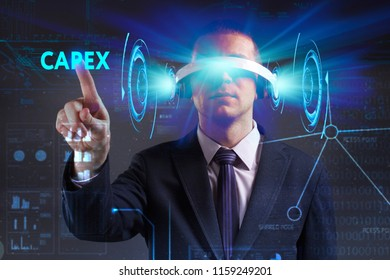 Business, Technology, Internet and network concept. Young businessman working in virtual reality glasses sees the inscription: Capex