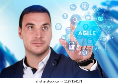 Business, Technology, Internet and network concept. Young businessman working on a virtual screen of the future and sees the inscription: Agile