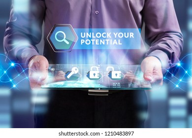 Business, Technology, Internet and network concept. Young businessman working on a virtual screen of the future and sees the inscription: Unlock your potential