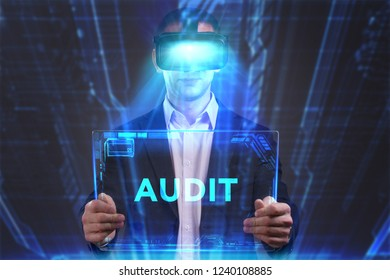 Business, Technology, Internet and network concept. Young businessman working in virtual reality glasses sees the inscription: Audit