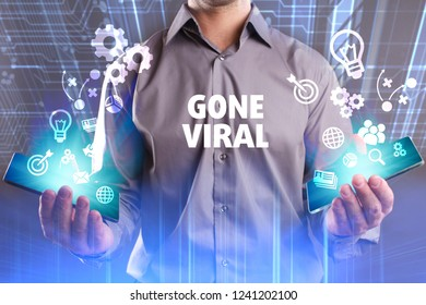 Business, Technology, Internet and network concept. Young businessman working on a virtual screen of the future and sees the inscription: Gone viral