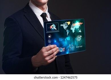 Business, Technology, Internet and network concept. Young businessman working on a virtual screen of the future and sees the inscription: IPv6