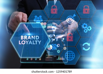 Business, Technology, Internet and network concept. Young businessman working on a virtual screen of the future and sees the inscription: Brand loyalty