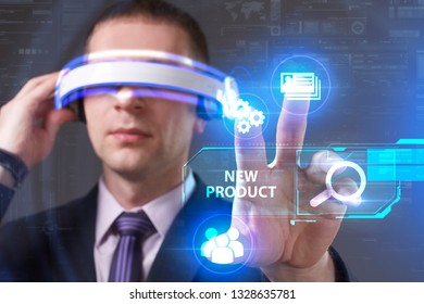 Business, Technology, Internet and network concept. Young businessman working in virtual reality glasses sees the inscription: New product