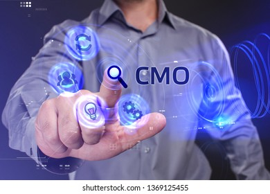 Business, Technology, Internet and network concept. Young businessman working on a virtual screen of the future and sees the inscription: CMO