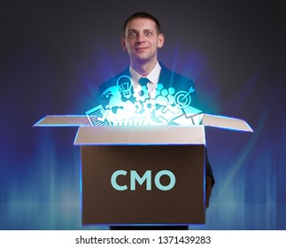 Business, Technology, Internet and network concept. Young businessman shows the word: CMO