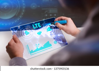 Business, Technology, Internet and network concept. Young businessman working on a virtual screen of the future and sees the inscription: LTE