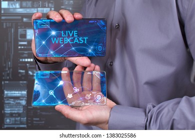 Business, Technology, Internet and network concept. Young businessman working on a virtual screen of the future and sees the inscription: Live webcast