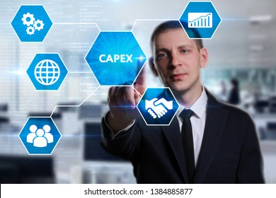 Business, Technology, Internet and network concept. Young businessman working on a virtual screen of the future and sees the inscription: Capex