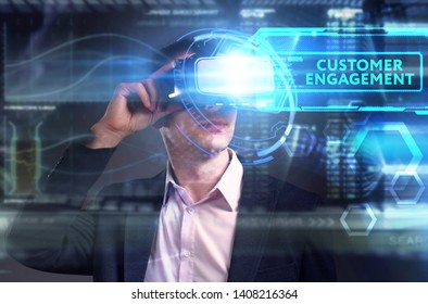 Business, Technology, Internet and network concept. Young businessman working on a virtual screen of the future and sees the inscription: Customer engagement