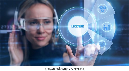 Business, Technology, Internet and network concept. Young businessman working on a virtual screen of the future and sees the inscription: License