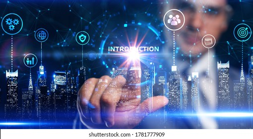 Business, Technology, Internet and network concept. Young businessman working on a virtual screen of the future and sees the inscription: Introduction.
