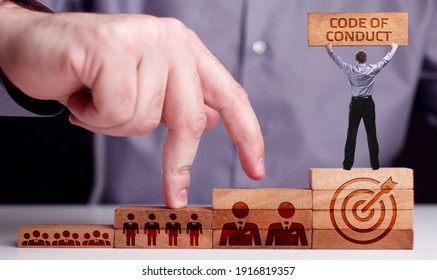 Business, Technology, Internet and network concept. Young businessman shows the word:Code of conduct