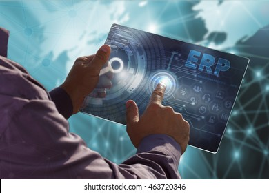 Business, Technology, Internet and network concept . Young business man working on the tablet of the future , select the virtual screen : ERP