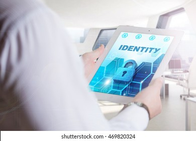 Business, Technology, Internet and network concept. Young business man, working on the tablet of the future, select on the virtual display: Identity
