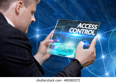 Business, Technology, Internet and network concept. Young business man, working on the tablet of the future, select on the virtual display: Access control