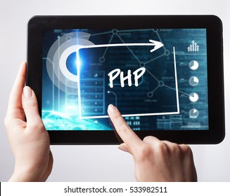 Business, Technology, Internet and network concept. Young businessman, working on the tablet , select on the virtual display: PHP