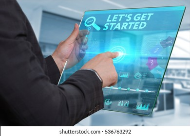 Business, Technology, Internet and network concept. Business man working on the tablet of the future, select on the virtual display: Let s get started