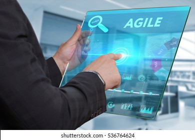 Business, Technology, Internet and network concept. Business man working on the tablet of the future, select on the virtual display: Agile