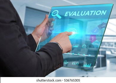 Business, Technology, Internet and network concept. Business man working on the tablet of the future, select on the virtual display: Evalution