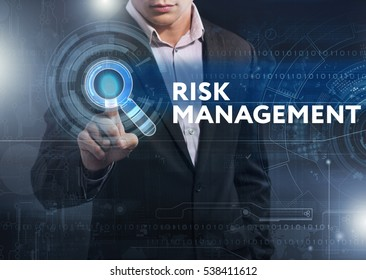 Business, Technology, Internet and network concept. Business man working on the tablet of the future, select on the virtual display: risk management