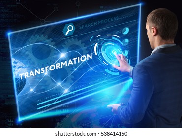 Business, Technology, Internet and network concept. Business man working on the tablet of the future, select on the virtual display: transformation
