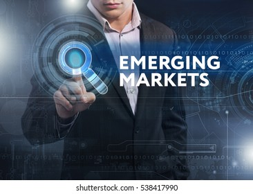 Business, Technology, Internet and network concept. Business man working on the tablet of the future, select on the virtual display: emerging markets
