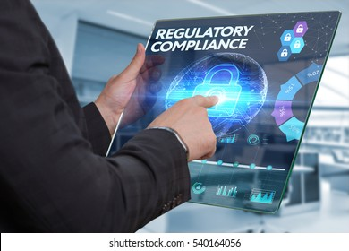 Business, Technology, Internet and network concept. Business man working on the tablet of the future, select on the virtual display: REGULATORY COMPLIANCE