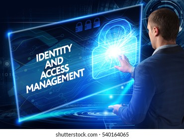 Business, Technology, Internet and network concept. Business man working on the tablet of the future, select on the virtual display: IDENTITY AND ACCESS MANAGEMENT